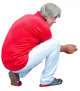 squatting man in red t-shirt 26