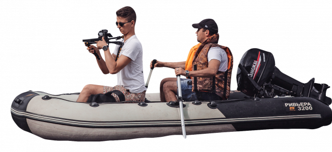 photographer on an inflatable boat 26